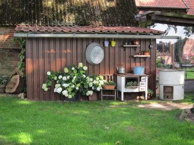 Liebevolle Gartengestaltung am Melkhus von Familie Delfenthal in Heber